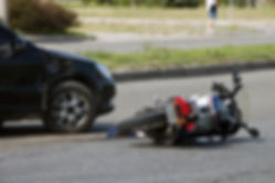 crash moto bike and car on road.jpg