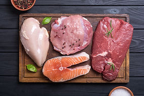 Mix of steak meat : salmon , beef , pork
