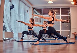 girls-are-enjoying-pilates-together-at-b