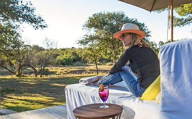 Lady relaxing with a cocktail at The River Lodge