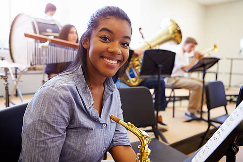 smiling-female-high-school-pupil-with-sa