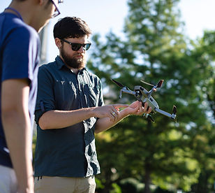 Interns Working with a Drone