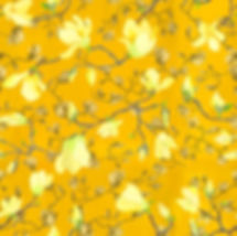 rich yellow wallpaper and fabric design with flowering magnolias