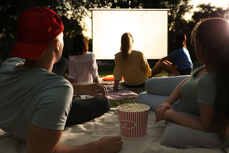 Young couple with popcorn watching movie