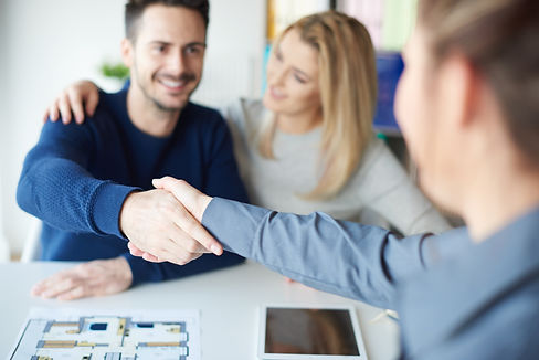 man-shaking-hands-with-real-estate-agent-K75ZC6G.jpg