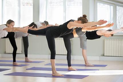 balancing stick yoga pose