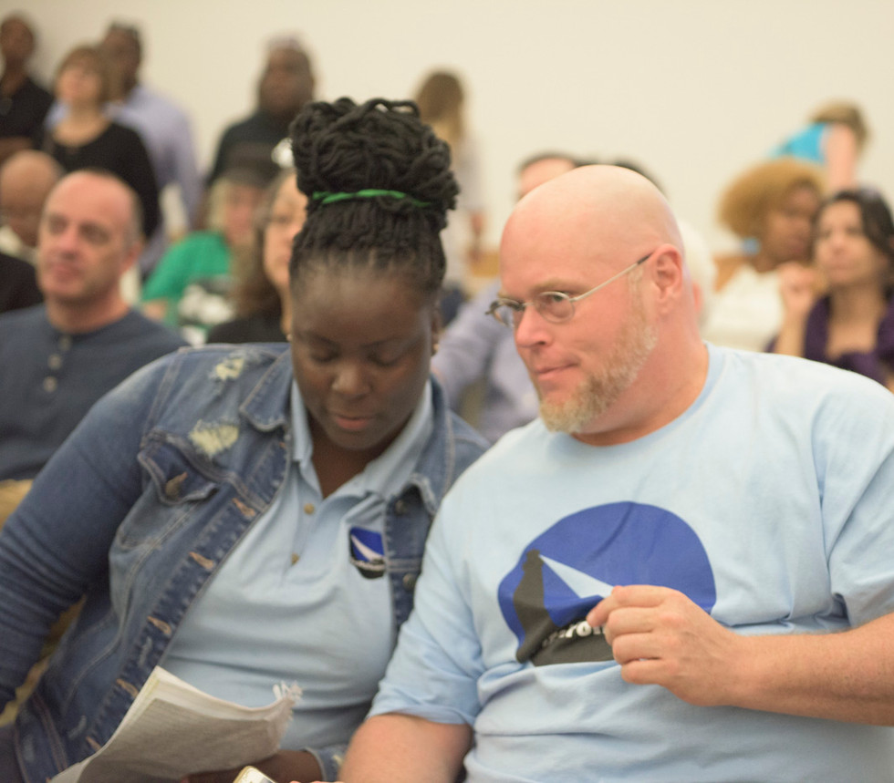 Mentors Tamika Davis and Chris Miner share notes during FirstFollowers_ CU Fees and Fines Event.jpg
