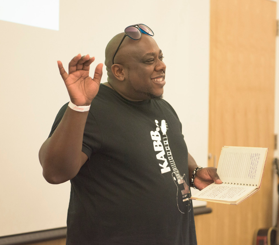 Spoken Word artist Aaron Wilson presenting a piece of his work at FirstFollowers_ CU Fees and Fines Event(1).jpg
