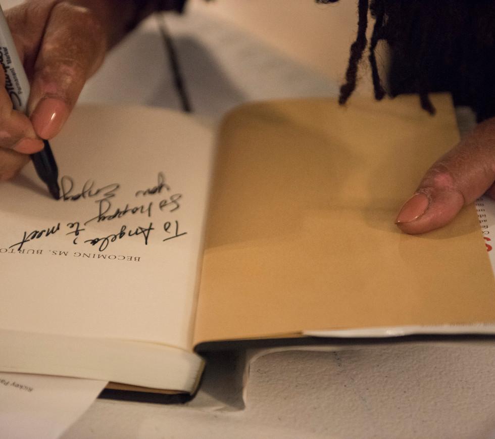 Susan Burton signing a copy of her book.