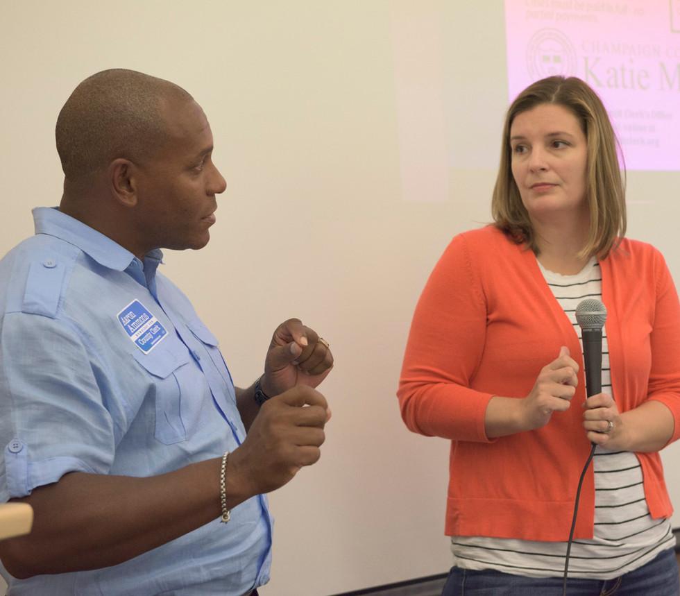 Urbana Alderman Aaron Ammons poses a question to Champaign County Circuit Clerk Katie Blakeman.jpg