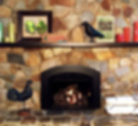 Rustic stone fireplace with arched gas insert