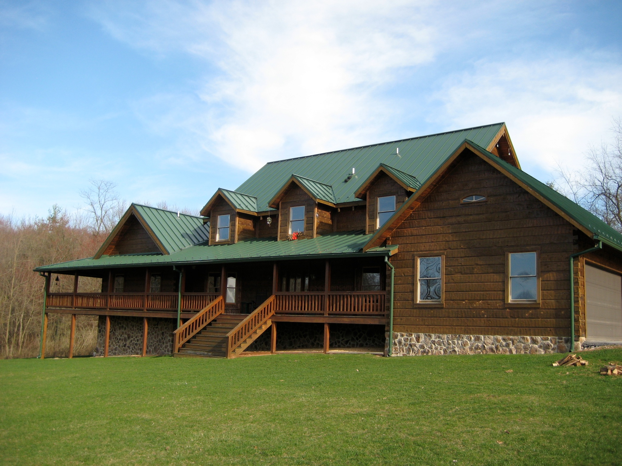 Log Home with Long Front Porch!