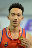 Former University of Birmingham scholarship athlete Lawrence Davis with his gold medal from BUCS indoors triple jump