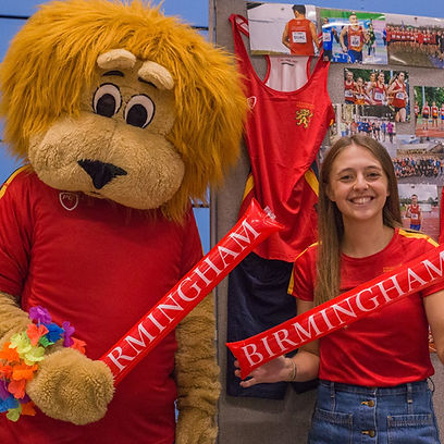 Former University of Birmingham women's cross country captain Emma Houchell on a stand at an open day with University of Birmingham Sport mascot Rory the lion