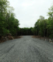 Rue en rond point, projet domiciliaire Les Boisés de l'Ange-Gardien