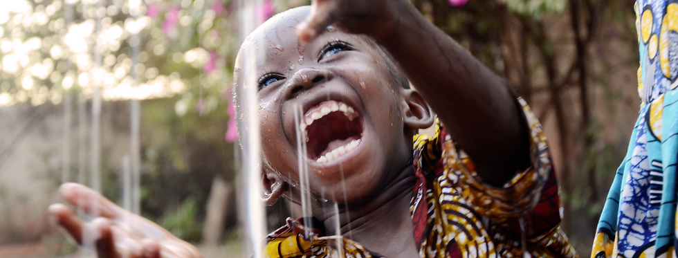 Boy playing with water cover.png