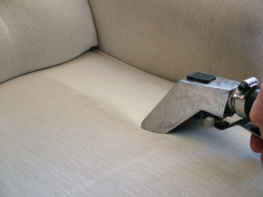 cleaning upholstery with tool