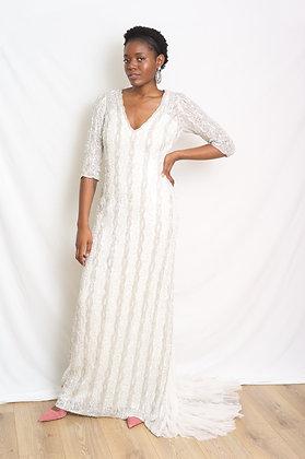 Long sleeved sequin wedding dress