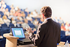 Middle-age man giving speech to audience