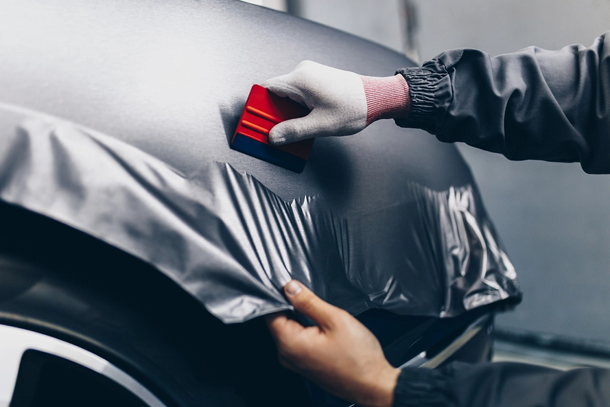 car-wrapping-specialist-putting-a-black-