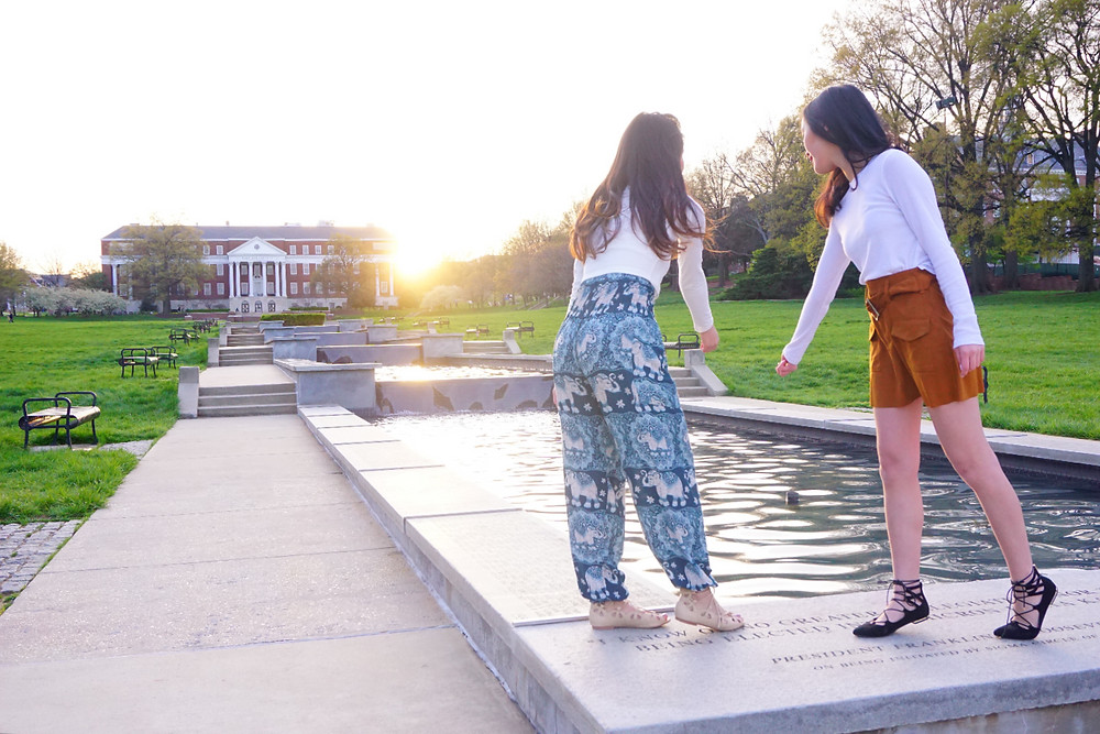 Two girls at OKG Fountain at University of Maryland