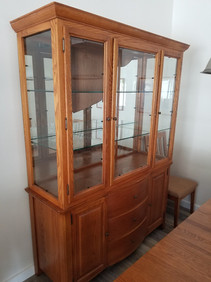 Moving damage to this hutch (see the broken glass and misaligned door?)