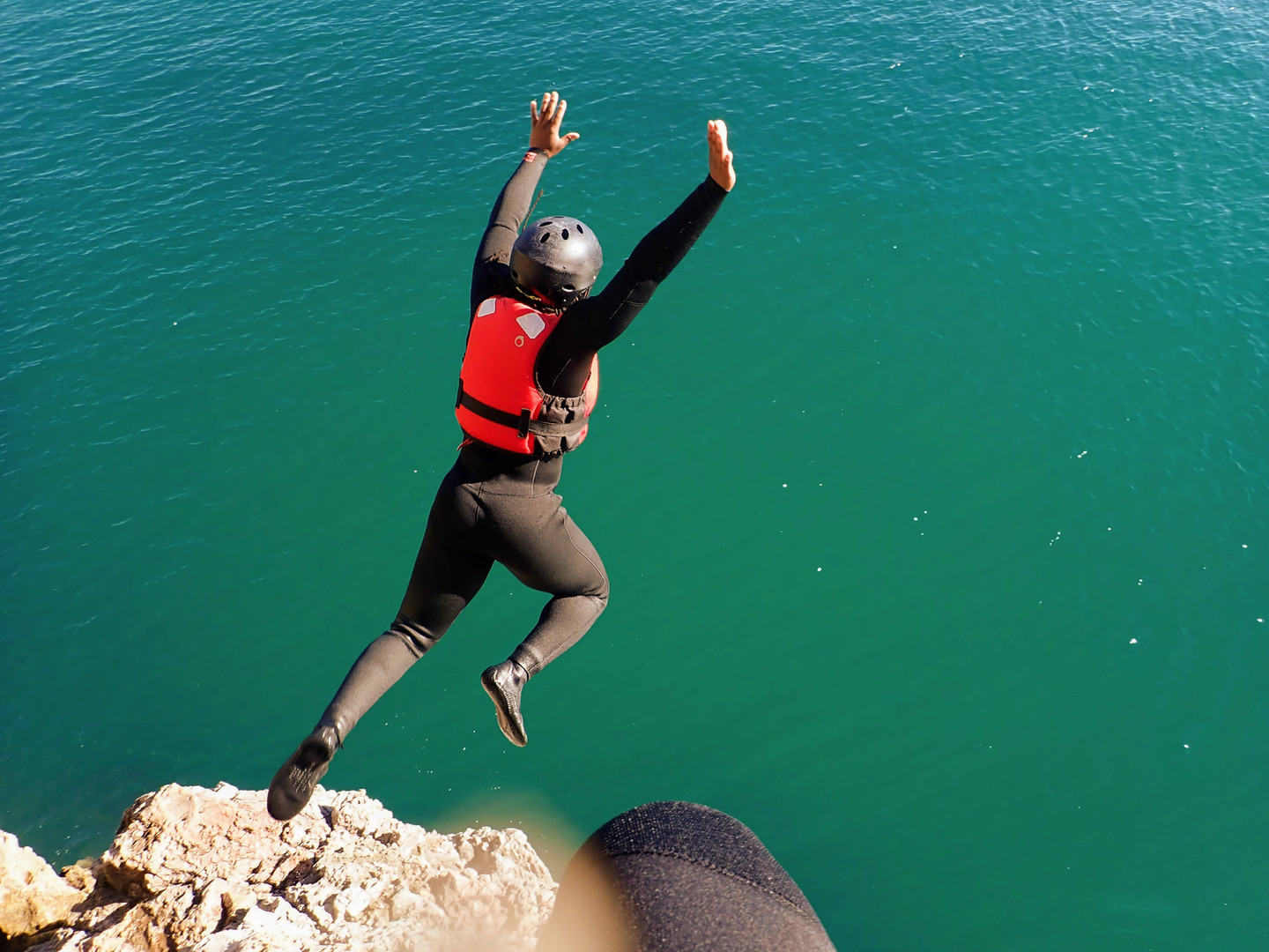 Medium height cliff jump Coasteering Algarve