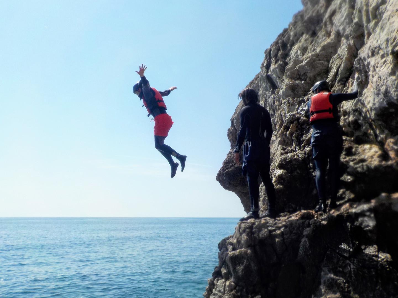 Big cliff jump into the Atlantic Ocean
