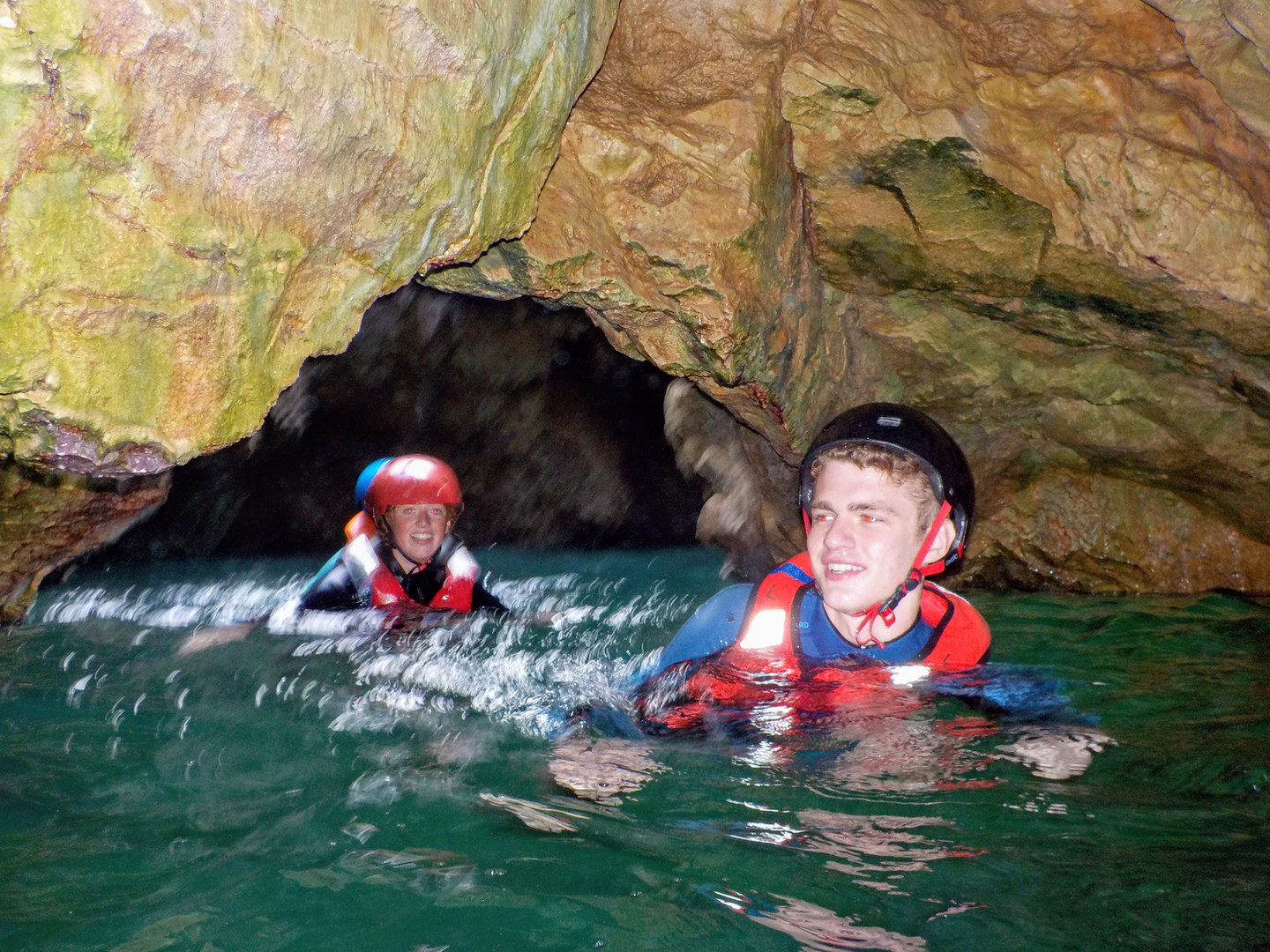 Adventure swimming through grottoes in Algarve