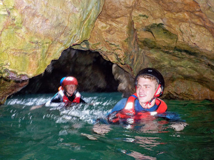 Adventure swimming through grottoes in Algarve