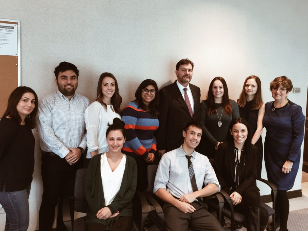 CLA volunteers pose with the Honourable SCC Justice R. Wagner and ED Marion Overholt