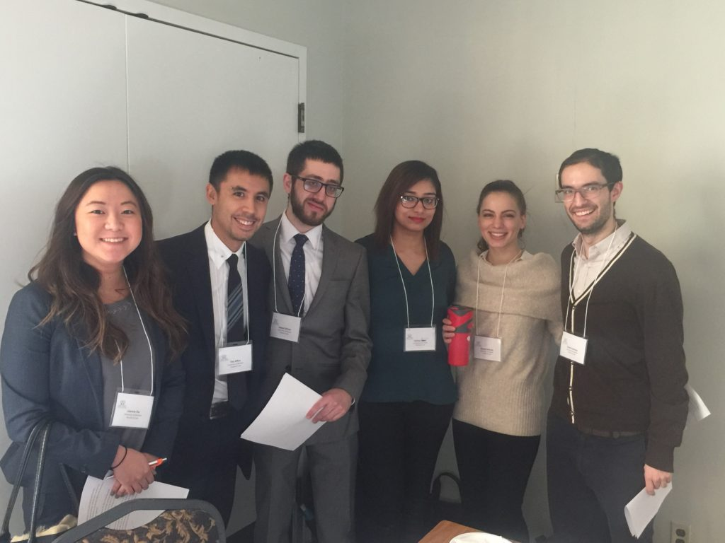 Group leaders and student volunteers presenting at the Windsor Essex Law Institute