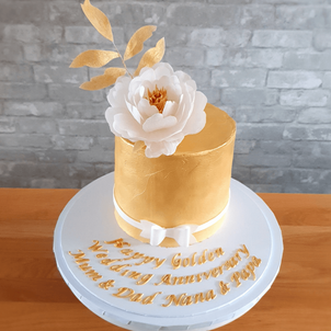 Anniversary cake with edible wafer paper peony.png