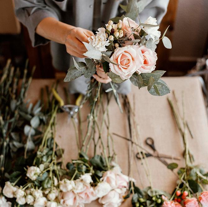 woman-making-beautiful-floral-bouquet.jp