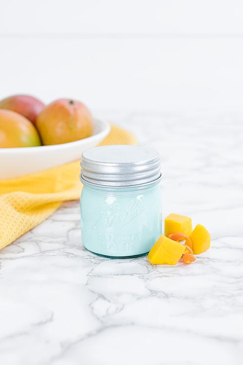 Mango Citrus 8 oz blue jar candle by Antique Candle Co.