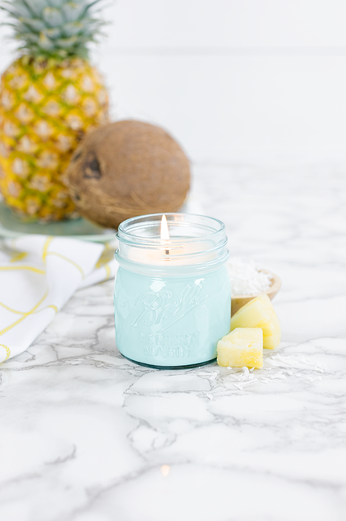 Pineapple Coconut 8 oz blue jar candle by Antique Candle Co.