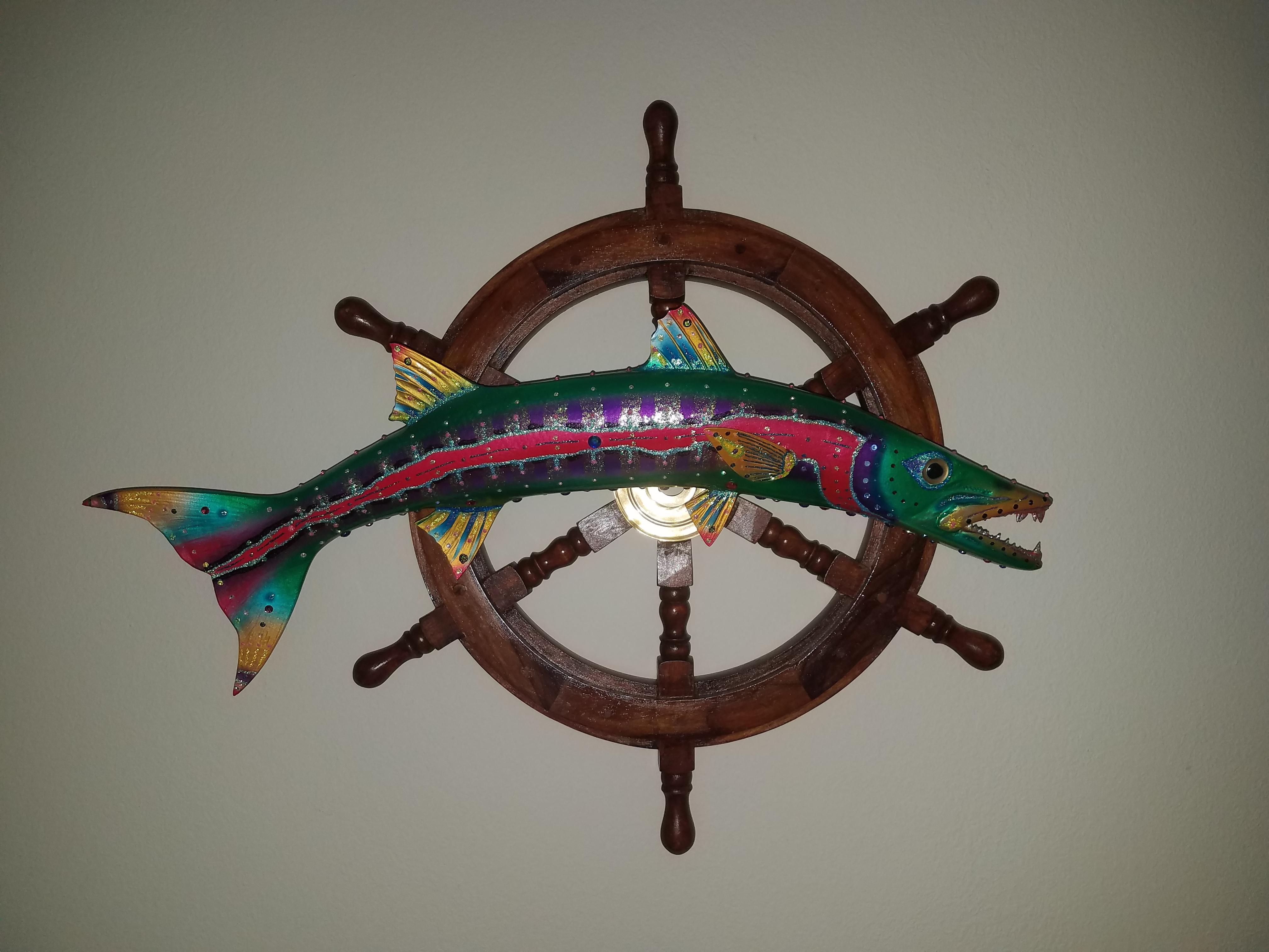 Barracuda on Ship's Wheel
