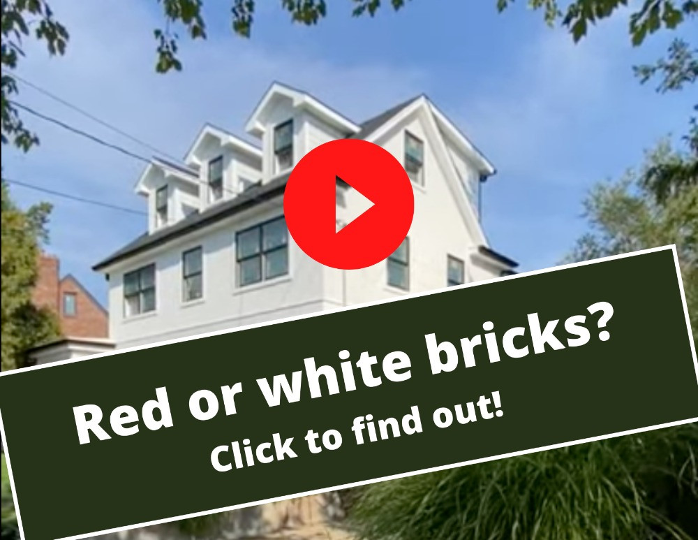 """The top level of a white home with a red play button in the middle and a banner reading """"Red or white bricks? Click to find out!"""""""