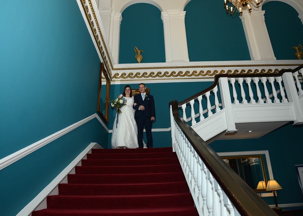 This grand staircase is a sight to behold within the front lobby of Lynford Hall.
