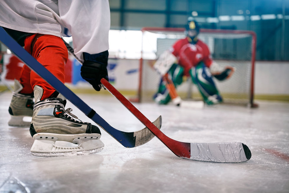 ice hockey player in action kicking with
