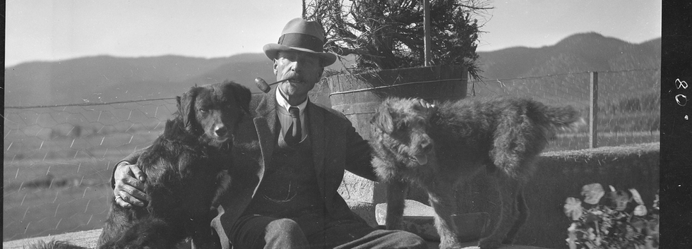 The Harwood's potential as an educational institution had interested the University as early as 1929 when it opened its Field School of Art at the Harwood, a program which continued for twenty-six years. Here Burt sits with his beloved dogs.