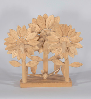 Orlinda Sherwood López Three Flowers, c. 2005 aspen wood carving entire piece: 12 1/2 × 13 × 8 in. (31.8 × 33 × 20.3 cm) Courtesy of Floyd Lucero and Maria Padilla