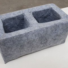 "J. Matthew Thomas CMU Block Pillow,2020 Polyester Craft Felt Fabric, polyester fabric backing, polyester fiberfill, polyester thread 8"" x 8"" x 16"" Courtesy of the artist"