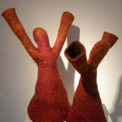 "Nina Silfverberg  Reach, 2020  Felted Finnish lamb's wool  7-9 sculptures, varied dimensions: 10"" x 12"" x 5"", 7"" x 8"" x 5""  Courtesy of the artist"