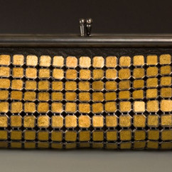 """Maria Samora Lauren Clutch, 2010 Keum boo, 24k Gold and Oxidized Sterling Silver, Citrine Bullet Cabochons, buckskin and silk 9"""" x 4"""" Courtesy of the artist"""