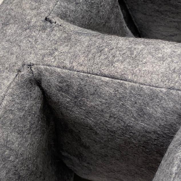 "J. Matthew Thomas  CMU Block Pillow (detail)  2020  Polyester Craft Felt Fabric, polyester fabric backing, polyester fiberfill, polyester thread  8"" x 8"" x 16""  Courtesy of the artist"