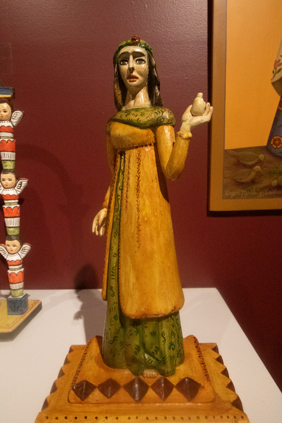"""Although there is very little proof that women took part in the early creation of S aints, that changed in the early 1900s. Female carvers from Cordova, New Mexico that followed in the tradition of their elder family members began to emerge. These artists and others like them became known as """"Santeras"""", the female counterpart to the Santeros."""