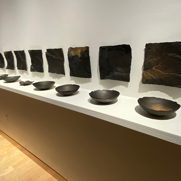 Afton Love  16 Faces and 16 Bowls 2019   Hand-dug micaceousclay  16 feet (variable)  Courtesy of the artist