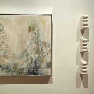 """Right Jan Sessler Wave Relic No.1 2020 Cement, earth, sand, paper, ribbon 8.5 x 3 x 5 in.  Left Jan Sessler  Traces, 2020  Acrylic, sandpaper, paper wrappings, printed charts, newspaper, charcoal, and colored pencil on canvas  40"""" x 40"""" x 2""""  Courtesy of the artist"""