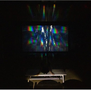 Sasha Raphael vom Dorp Rain Room, from the Sound Bending Light series, 9/23/2016-5/23/2020 Defracted rain water falling; experiential installation with 1-channel video and wood benches enhanced with vibration tactile transducers, ed. 1/3 27:03 minute loop